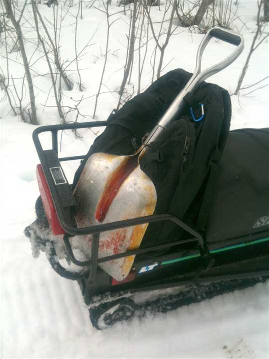 Shovel tied on the back of my snowmachine